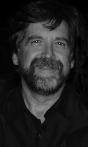 Black and white headshot of Mark Schweizer
